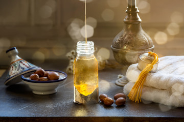 Bottle of Argan oil on a table with fruits
