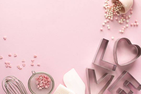 Frame of food ingredients for baking on a gently pink pastel background. Cooking flat lay with copy space. Top view. Baking concept. Valentine's Day. flat lay