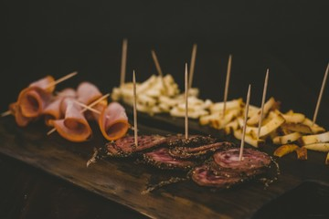 Closeup shot of baloney on a wooden board