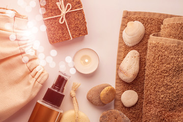 Foto op Aluminium Spa Spa and wellness concept, natural coffee scrub soap in cotton eco bag,essential oil cosmetic,peeling sand stone,towel,wooden haircomb.Beige dayspa set.Pastel bathroom accessories and products top view