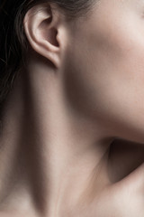 part of young woman neck and face closeup natural beauty care concept