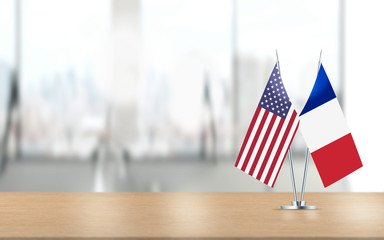 American and French Flags are Paired Together At Office Desk