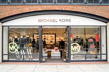 Entrance to Michael Kors shop in modern shopping mall