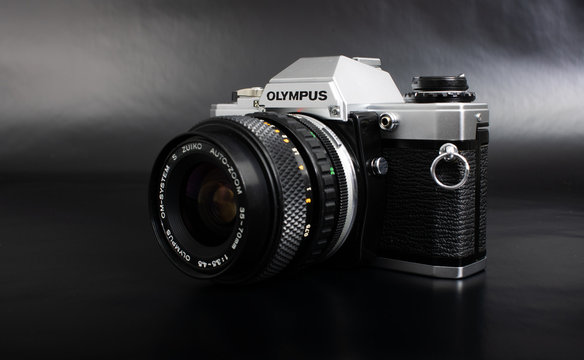 Prague, CZECH REPUBLIC - JANUARY 02, 2019: Olympus OM-10 is a 35mm film camera, launched by Olympus Corporation in June 1979, laid on dark background