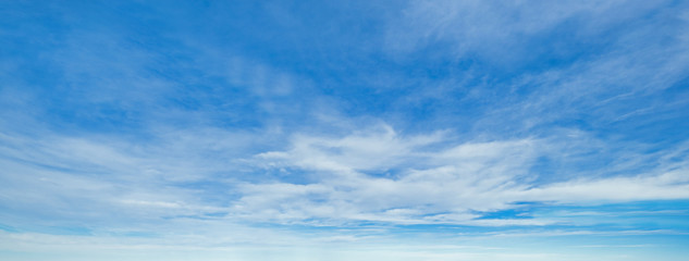 Blue sky background with clouds Wall mural