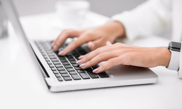 Cropped image of manager using her laptop computer