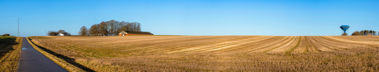 Aluminium Prints Blue Rural panorama landscape with a dry field