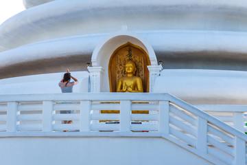 Woman praying at Japanese Peace Pagoda temple in Sri Lanka
