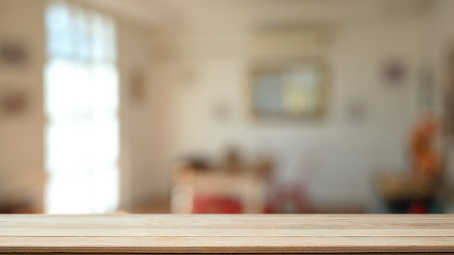 Montage wooden table in living room background with empty wood desk for present product.