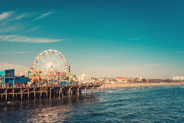 Santa Monica, CA, USA - Aug 2, 2018: Santa Monica iconic ferris wheel in amusement park in sunset light, view from pier