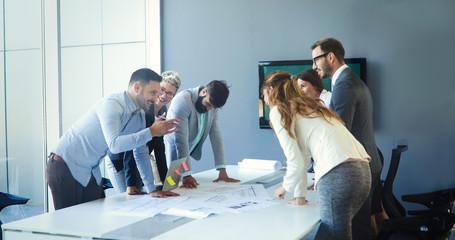 Fotobehang - Business people meeting around table
