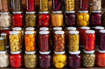 Lot of glass jars with a variety of pickled vegetables