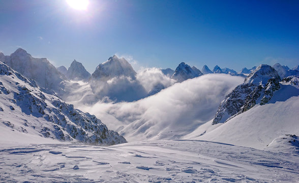 Breathtaking view of the snowy Canadian Rocky Mountains and valley on sunny day
