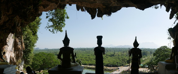 different statues of buddha at the entrance of a beautiful cave, Hpa An, Myanmar, Asia