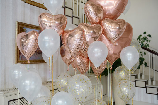 Wedding or birthday photo zone with pink and white balloons indoors, copy space. Holiday party decoration. Colorful balloons background. Valentines day