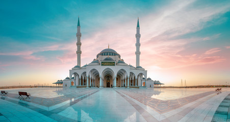 Sharjah Mosque Largest Masjid in Dubai, traditional Islamic architecture, Arabic Letter means: Indeed, prayer has been decreed upon the believers a decree of specified times, Travel and tourism image