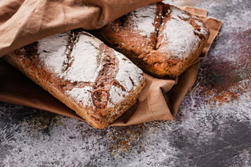 Photo Blinds Bread Freshly baked sourdough rye flour bread with sunflower and pumpkin seeds on a brown napkin. Copy space