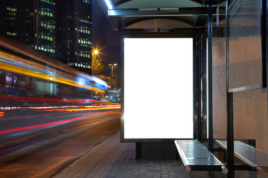 Blank billboard in night traffic