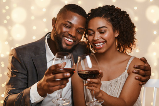 Portrait of beautiful happy african couple celebrating St. Valentine's Day