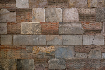 Old brick wall background. Ancient brickwork combined with big stone blocks