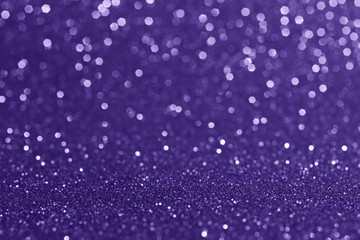 Abstract blurred background.Sparkling bokeh.Glitter texture.Outstanding ultra violet color.