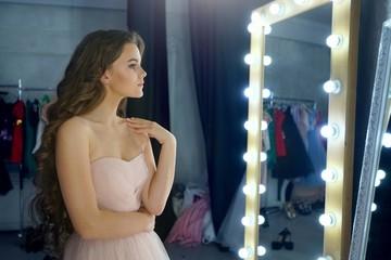 woman beauty portrait looking in mirror