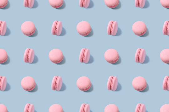 Sweet colorful macarons isolated on blue