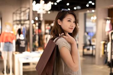 Elegant woman shopping in shopping mall
