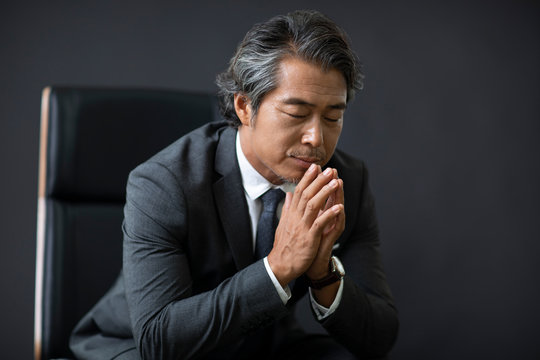 Confident businessman sitting on chair