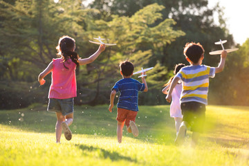 Little children playing on meadow