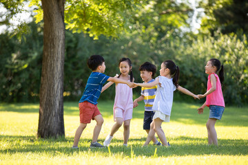 Happy children playing on meadow