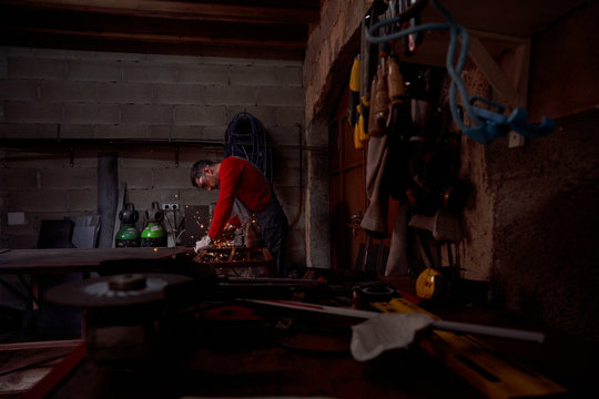 Blacksmith's table with tools and a blacksmith in the background working