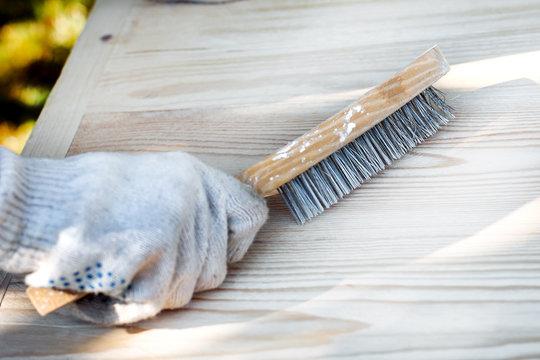 metal brush on wood