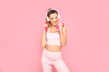 Smiling girl enjoying fitness training.