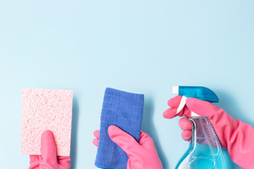 Three female hands holding spray bottle and rags, Spring cleaning concert.