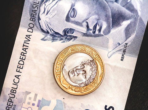 Brazilian Currency - BRL. One Real coin on a two Real banknote.