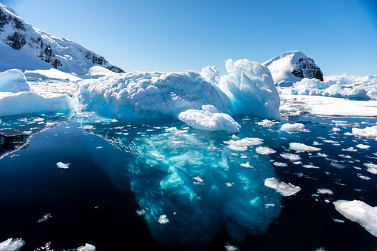 Closeup details of iceberg floating in the cold water of Antarctica