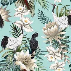 Tropical vintage crane bird, parrot, lotus flower, palm leaves, white orchid floral seamless pattern blue background. Exotic jungle wallpaper.
