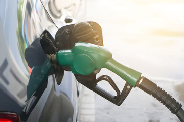 Petroleum Gas station. Fuel pump colorful petrol pump filling nozzles.car at gas station being filled with fuel