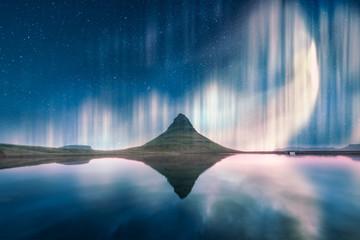 Aurora light behind Kirkjufell mountain in Iceland, Europe. Landscape photography