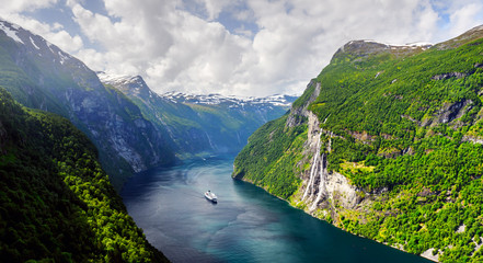 Foto op Canvas Bleke violet Panorama of breathtaking view of Sunnylvsfjorden fjord and famous Seven Sisters waterfalls, near Geiranger village in western Norway. Landscape photography