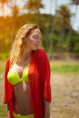 Portrait of Very beautiful slim woman on a wild tropical beach