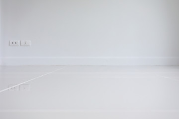 empty room interior, white mortar wall and clean tile floor in a new house