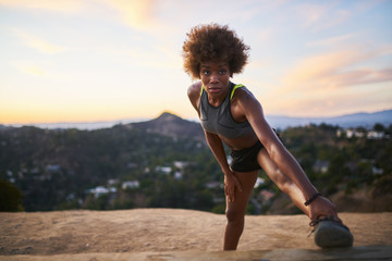 athletic african american woman doing stretches at runyon canyon