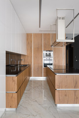 Stylish kitchen with wooden furniture
