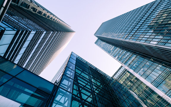 London Docklands skyscrapers. Low, wide angle view of converging glass and steel contemporary skyscrapers.
