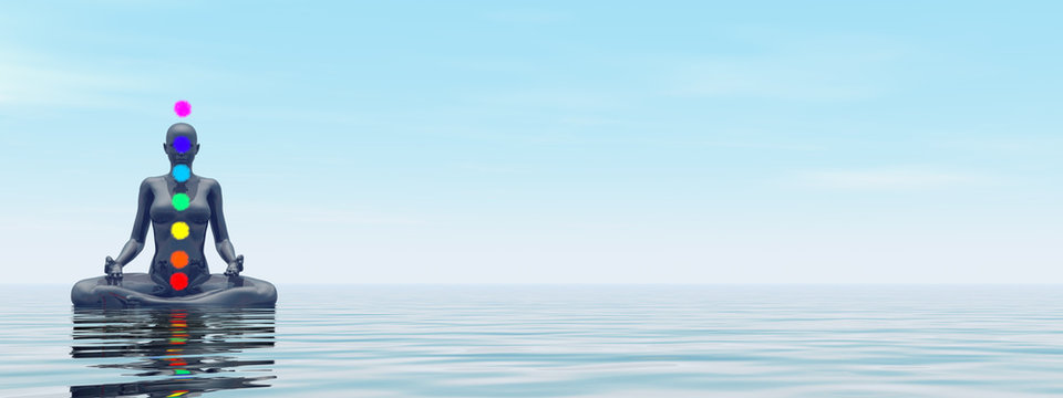 Woman meditating upon the ocean and chakra colors - 3D render