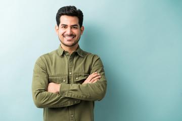 Confident Smiling Man Standing In Studio Fotobehang