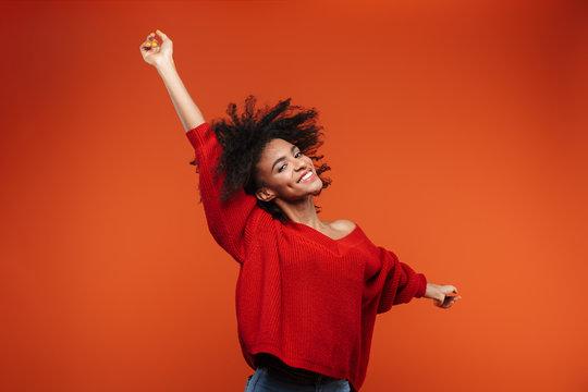 Beautiful young african woman wearing sweater