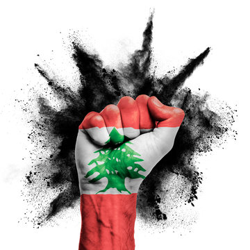 Lebanon raised fist with powder explosion, power, protest concept